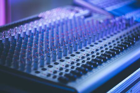 Professional music production in a sound recording studio, mixer desk Banque d'images