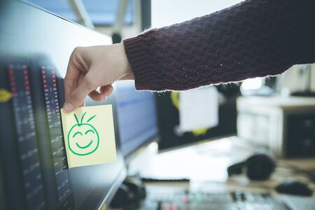 Feedback and motivation concept: Smiley Illustration at the working place