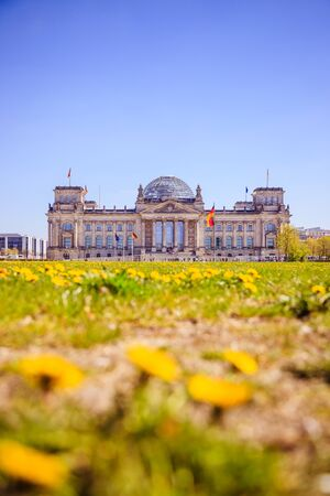 Picture of the Reichstag in Berlin in Springtime, green grass and flowers