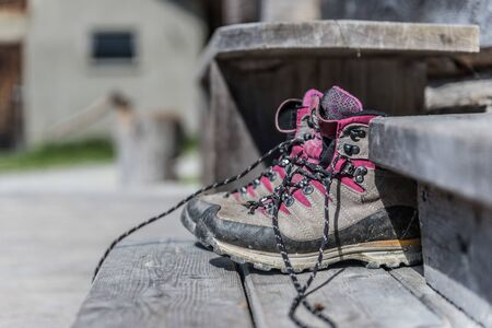 Close up picture of hiking boots on a rustic wooden veranda of an alpine hut Zdjęcie Seryjne