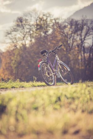 Parked bicycle on a field, autumn time