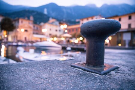 Italian harbour in the evening, small cute village and lighrs in the blurry background
