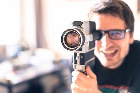 Filmmaker is doing a movie, vintage old movie camera