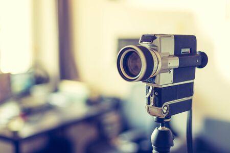 Vintage old movie camera indoor, copy space