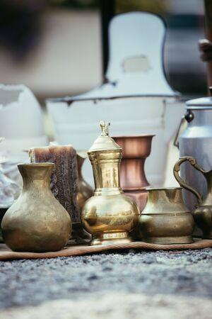 Antique teapots and cups on a flea market, outdoors Reklamní fotografie