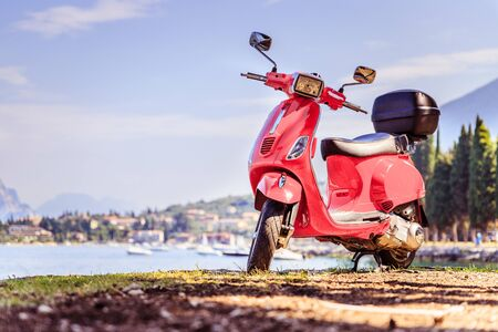 Beautiful red scooter on the beach, landscape and blue sky