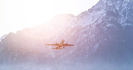Aircraft is taking off, idyllic mountain range in the background Фото со стока