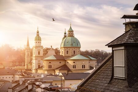 Rooftops of Salzburger Cathedral, Houses and Churches in the evening. Stunning atmosphere. 스톡 콘텐츠