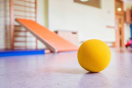 Close up of toy foam ball in a gym hall of a Kindergarten