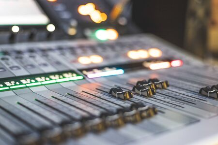 Professional music production in a sound recording studio. Sound engineer is working.