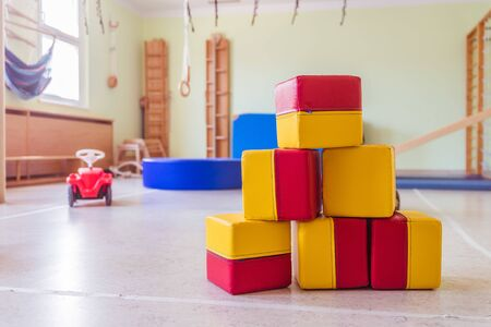 Close up of toy foam cubes in a gym hall of a Kindergarten