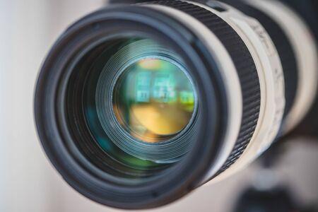 Close up of professional photo camera on a tripod, lens Фото со стока