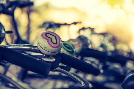 Colorful bike bells on parked bikes, urban city life