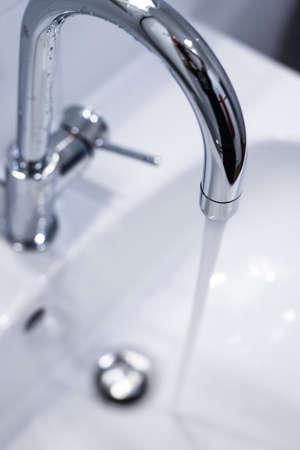 Close up of a water spigot in a clean bathroom. Water saving. Reklamní fotografie