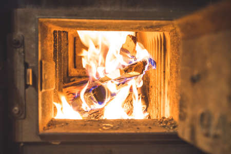 Blaze fire flame in stove, orange and black Standard-Bild