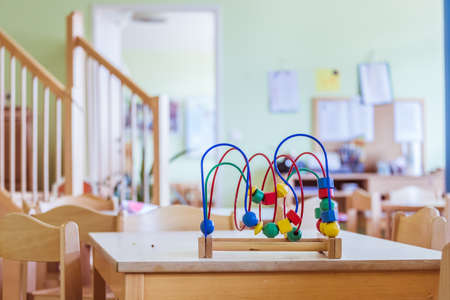 Close up of colorful wooden toy for learning and socialization