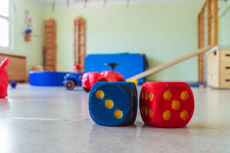 Close up of toy foam cubes in a gym hall of a kindergarten Stockfoto