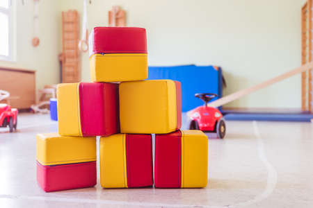 Close up of toy foam cubes in a gym hall of a kindergarten 版權商用圖片