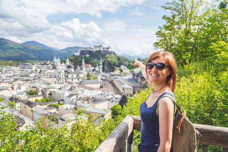 Female tourist is enjoying the view over the historic district of Salzburg Banco de Imagens