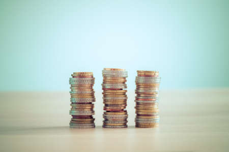 Coins stacked on each other, close up picture, market crisis and financial aid concept