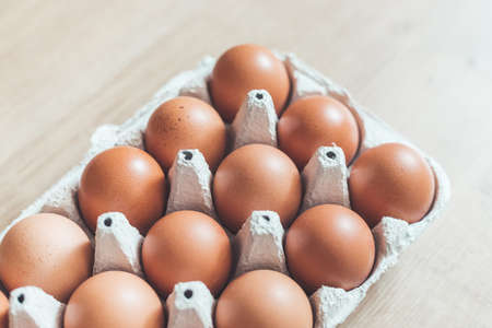 Top view of chicken eggs in a basket.