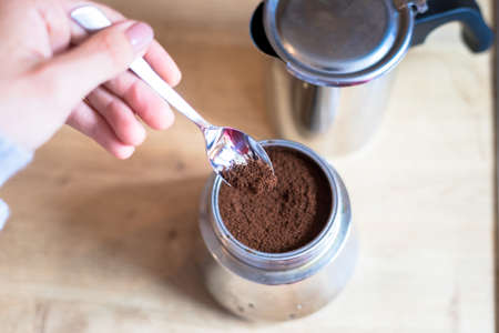 Preparing coffee: Close up of coffee powder in a vintage coffee cooker
