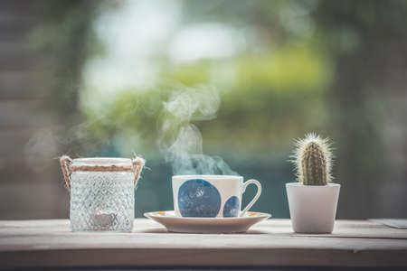 Enjoying a cup of tea in the own garden, copy space