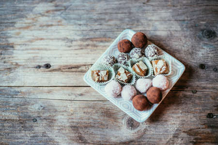 Closeup of variety of traditional European homemade Christmas cookies on rustic wooden desk