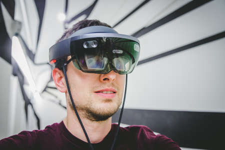 Young man is using virtual reality glasses or headset