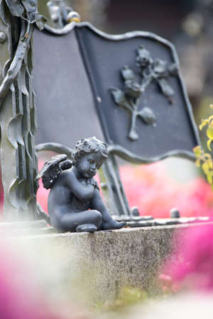 Iron angel on a grave at a cemetery