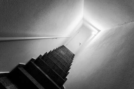 Basement stairs with balustrade, closed white door