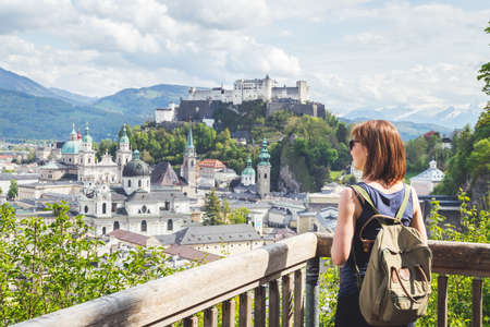 Female tourist is enjoying the view over the historic district of Salzburg 新聞圖片