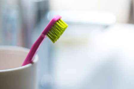 Colorful toothbrush in the bathroom, morning routine