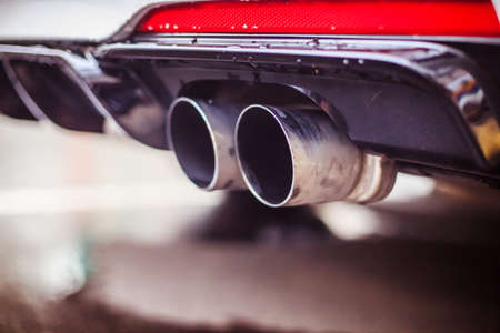 Close up of an exhaust pipe of a car, environmental pollution 版權商用圖片