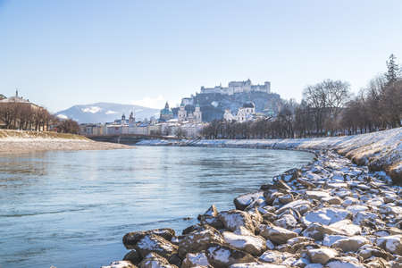 Panorama of Salzburg in winter, snow river bank, historical center, river Salzach