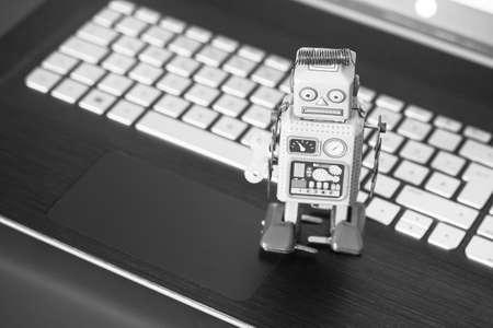 Symbol for a chat bot or social bot and algorithms, laptop Standard-Bild
