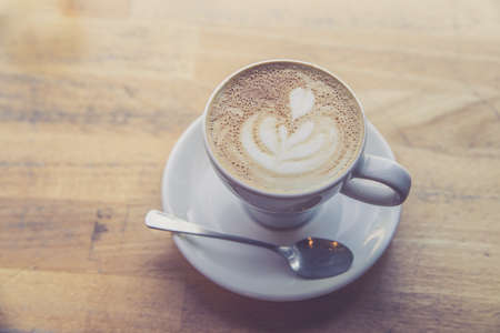 Cup of fresh brewed cappuccino in an Italian café