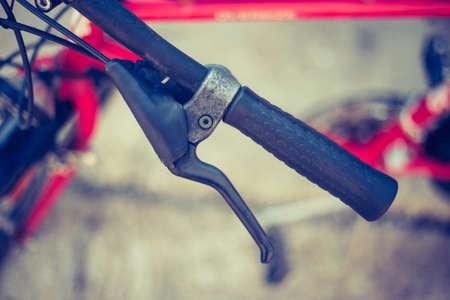 Closeup picture of a bicycle handlebar and breaks, bike repair, blurred background