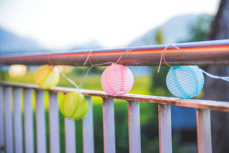 Colorful lampions outside, evening, garden party