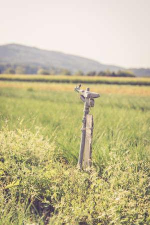 Irrigation plant on an agriculture field, summer day, soil Standard-Bild