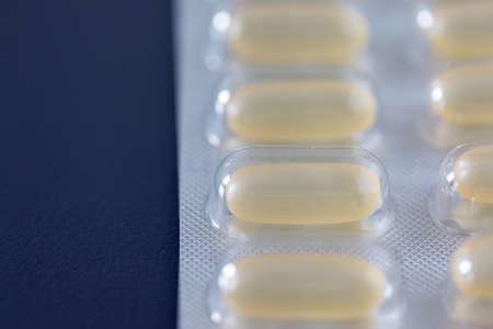 Pills / medicine lying on the gray table, flu season