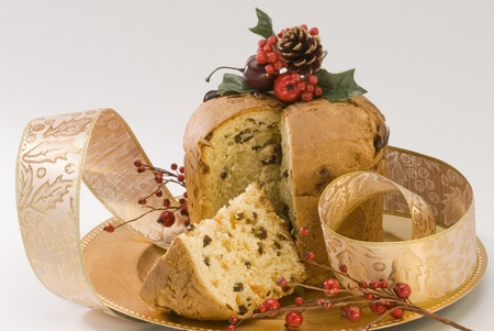christmas cake: Panettone.Traditional italian Christmas cake filled with raisins and candied orange peels.
