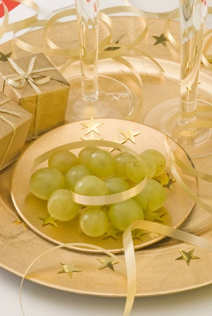 Two glasses of champagne with twelve grapes of luck and New Year photo