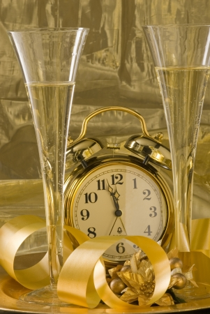 Old clock between two glasses of champagne and New Year photo