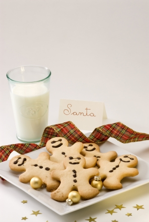 Traditional Christmas gingerbread man cookies and a glass of milk for Santa Stock Photo
