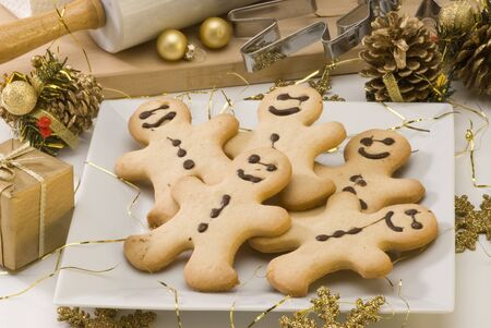 gingerbread: Traditional Christmas gingerbread man cookies in a white plate  Stock Photo