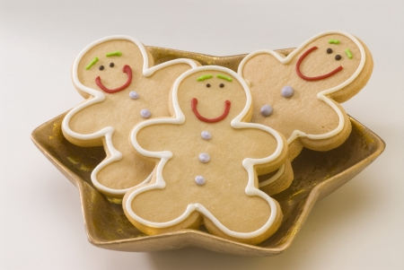 Traditional Christmas gingerbread man cookies in a golden plate  photo