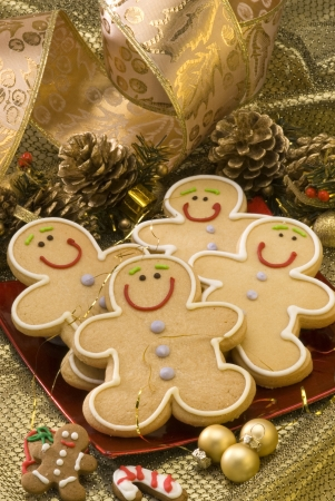 holiday food: Traditional Christmas gingerbread man cookies in a red plate  Stock Photo