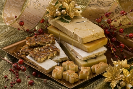 Typical Spanish Christmas nougat in a golden plate Stock Photo