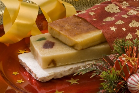 Typical Spanish Christmas nougat in a red plate